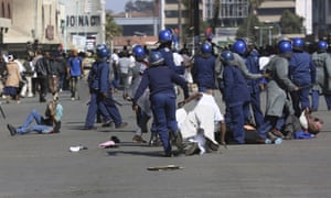 Chaos in Harare as Zimbabwe riot police violently disperse protesters