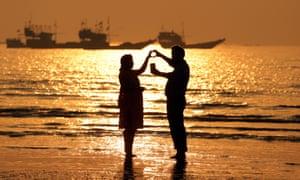 A couple take a selfie as they celebrate Valentine's Day on Gorai beach in Mumbai, India.
