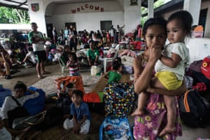 Villagers take shelter at a school