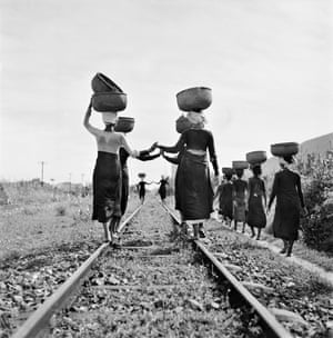 Cham women returning from the market, Barau, Indochina. 1952