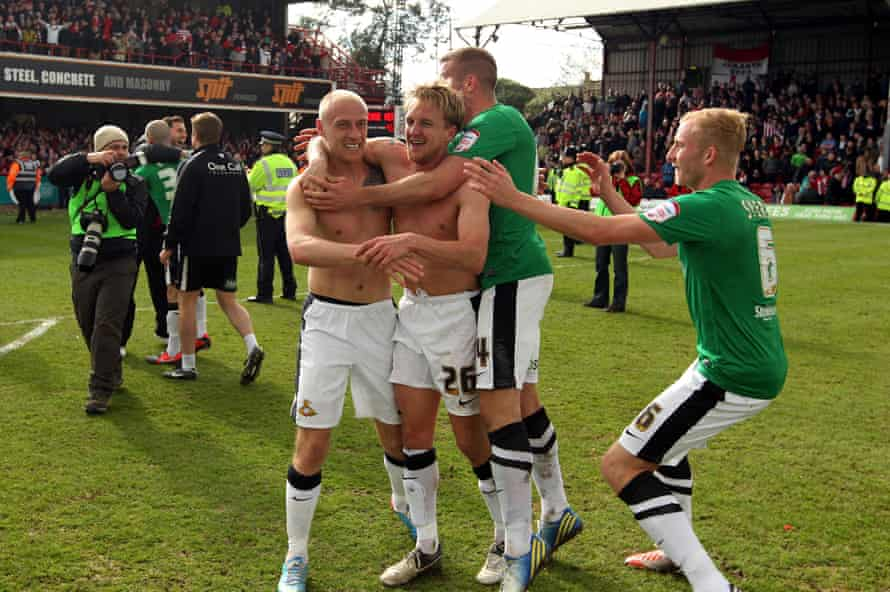 James Coppinger celebrates with Doncaster teammates after scoring the goal that at Brentford that earned promotion to the Championship in 2013.