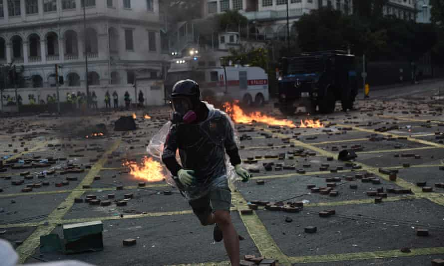 A protester throws a molotov cocktail at police in Hong Kong in November 2019