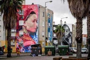 Murals by Liberian artist Arcy (left) and Portuguese artist Huariu