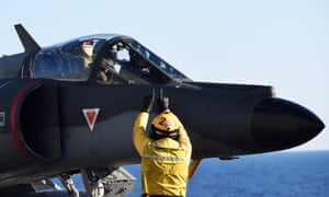 A French Super Etendard jet fighter aboard the French Charles-de-Gaulle aircraft carrier on the Mediterranean Sea.