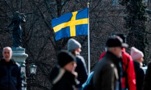 The Swedish flag is seen in Stockholm during the the coronavirus pandemic.