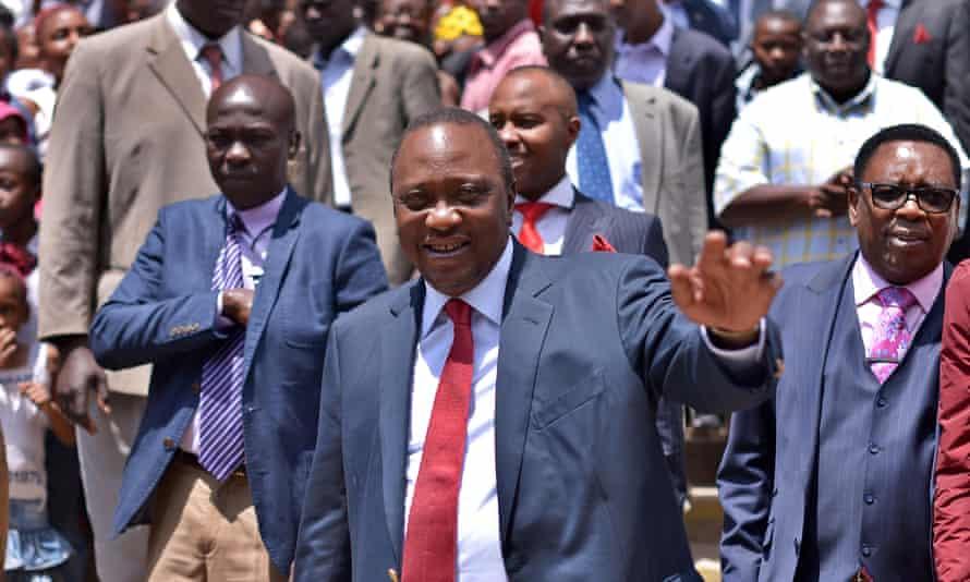 Uhuru Kenyatta greets the crowd after attending church.