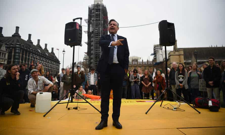 Jon Ashworth speaks during a Extinction Rebellion protest at Parliament Square in London