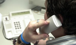 person making a phone call from a landline