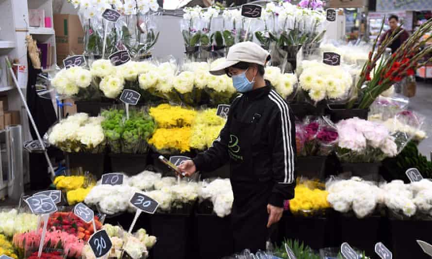 A florist arranges her Mother's Day display in Melbourne