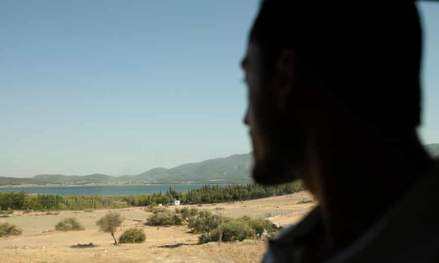 Ahmed silhouette against Greek countryside