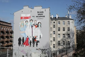 Warsaw, Poland A mural showing medical personnel wearing protective masks