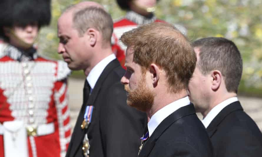 William and Harry walking behind the coffin