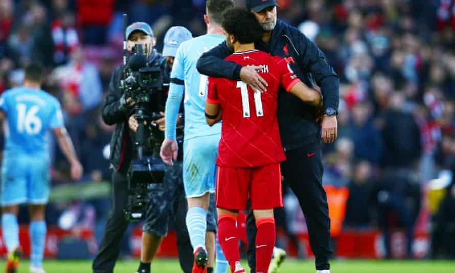 Jurgen Klopp hugs Mohamed Salah after the pulsating draw with Manchester City.