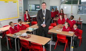 Michael Gosling with pupils at Akroydon primary