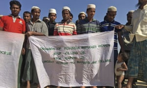 Rohingya refugees in Bangladesh hold banners expressing their fears over being sent back to Myanmar.