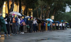 Voters wait in line to cast their early ballots at the Coral Gables Branch Library precinct in Florida.