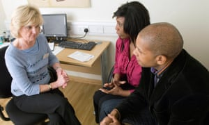 A woman suffering from depression and her husband consult with a GP at a clinic.