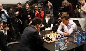 Norway's Magnus Carlsen, right, takes on the Italian-American Fabiano Caruana at the World Chess Championship