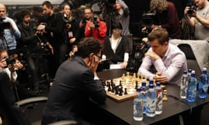 Magnus Carlsen (right) and Fabiano Caruana on the final day of the World chess championship.