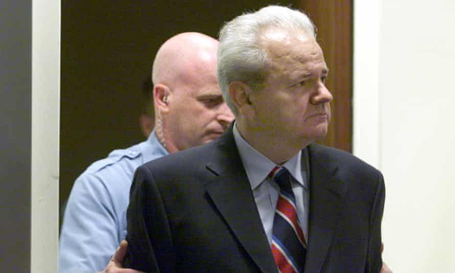 Former Yugoslav president Slobodan Milošević is led into the UN war crimes tribunal during his five-year trial.