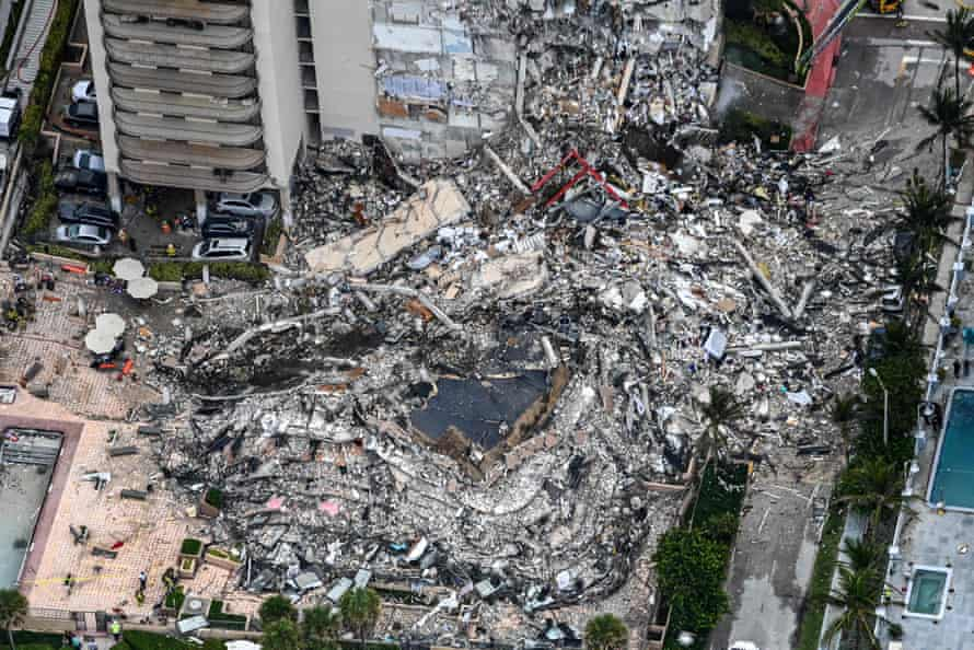 Search and rescue personnel working on site after the partial collapse of the Champlain Towers South in Surfside, north of Miami Beach, on 13 July.
