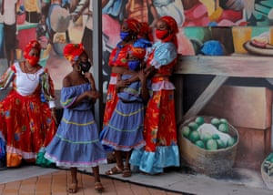 Traditional Haitian dancers wearing blue and red