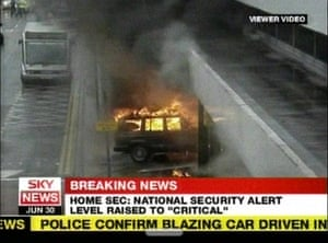 The Jeep Cherokee car on fire after being driven into the door of Glasgow airport during a failed car bomb terrorist attack on the airport. Kafeel Ahmed, previously president of Queen's University Belfast Isoc, died in the attack.