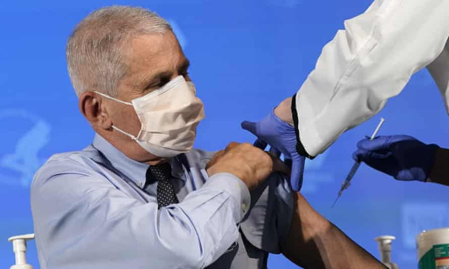 Dr Anthony Fauci, director of the National Institute of Allergy and Infectious Diseases, prepares to receive his first dose of Covid-19 vaccine.