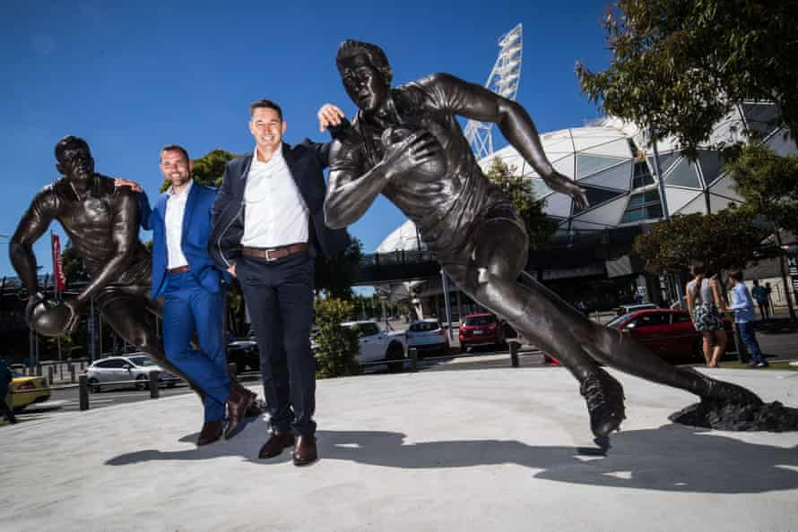 Cameron Smith poses with Billy Slater alongside their statues outs AAMI Park.