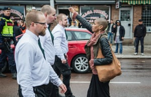 A lone woman stands with raised fist opposite the uniformed demonstrators in Sunday's Nazi demonstration in Borlange, Sweden.