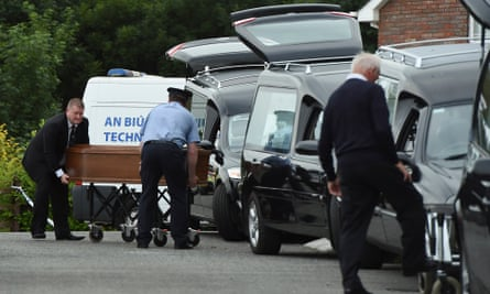 Coffins are carried to hearses in Ballyjamesduff, Co Cavan, following the tragedy.