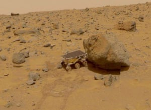 Nasa's Sojourner Rover analyses the Yogi Rock on the surface of Mars, during the Mars Pathfinder exploratory mission in July 1997.