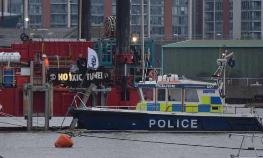 Police arrive at the scene of the Extinction Rebellion protest on the Thames early on Saturday morning.