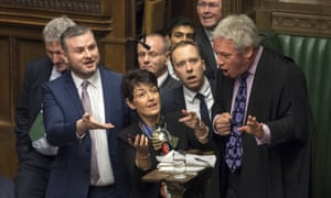 John Bercow surrounded by MPs in the Commons