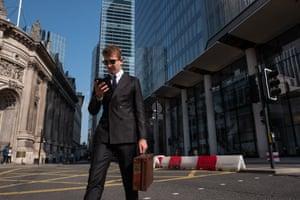A man crosses a deserted Bishopsgate, September 2020