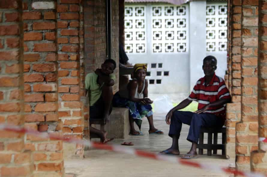 Suspected Ebola sufferers wait at a treatment centrein the Congolese town of Bikoro