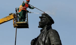 Workers wash a statue of Lenin in Krasnoyarsk, his birthplace