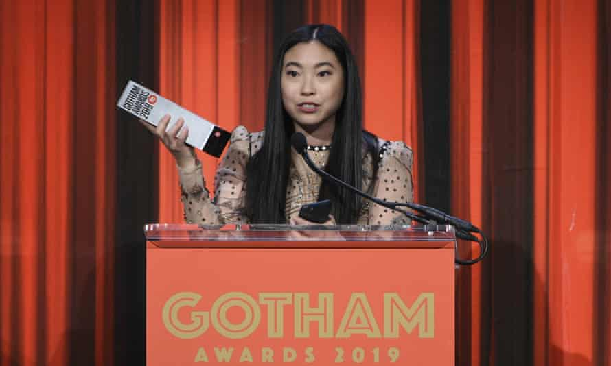 Awkwafina accepts the Gothams' best actress award for The Farewell.
