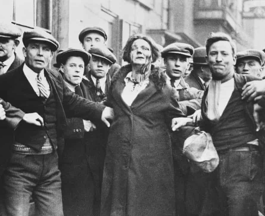 Blood runs from a woman's face during unemployment riots in Bristol in 1932.