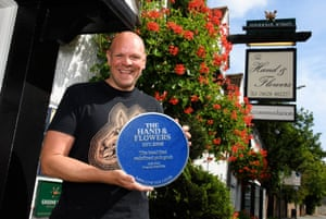 Tom Kerridge with a personalised blue plaque presented by the model and racing driver Jodie Kidd, outside the Hand and Flowers in Marlow, Bucks.