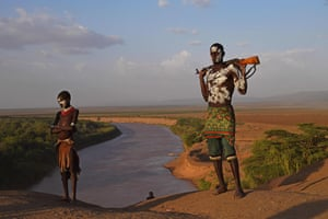 Members of the Karo tribe stand by the Omo river