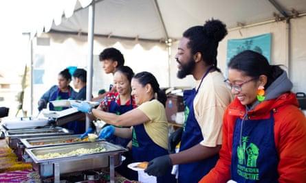 People's Kitchen Collective volunteers serving free breakfast.