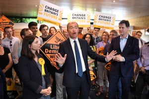 Liberal Democrats leader Tim Farron speaks as Nick Clegg MP looks on during a rally at the Shiraz Mirza Community Hall in Kingston upon Thames