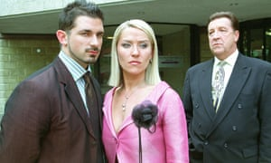 John Forgeham, right, as Frank Laslett, the wheeler-dealer chairman of Earls Park FC in Footballers Wives, with Zöe Lucker, centre, and Cristian Solimeno.