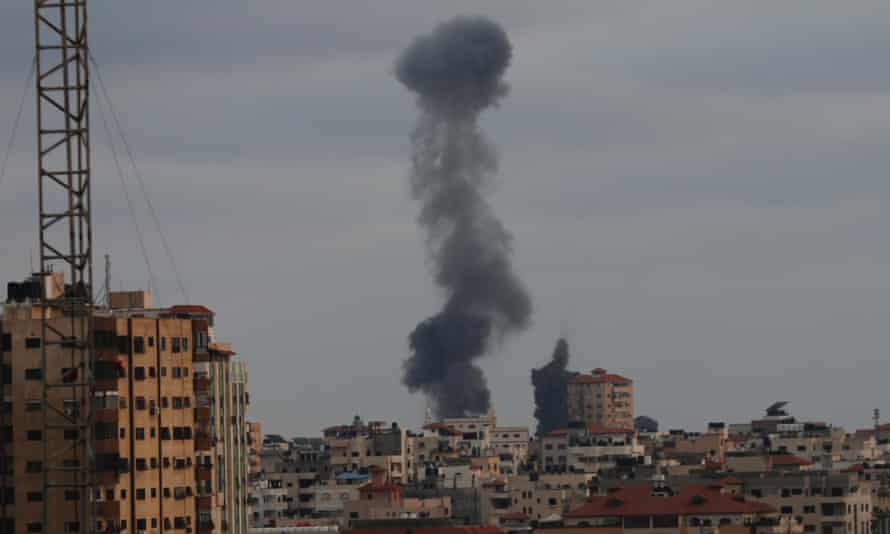Smoke billows at an industrial area during an Israeli air strike in Gaza earlier on Thursday. The conflict has cost 232 lives in Gaza and 12 in Israel.