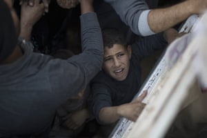 A boy asks for food being distributed in Mosul, Iraq