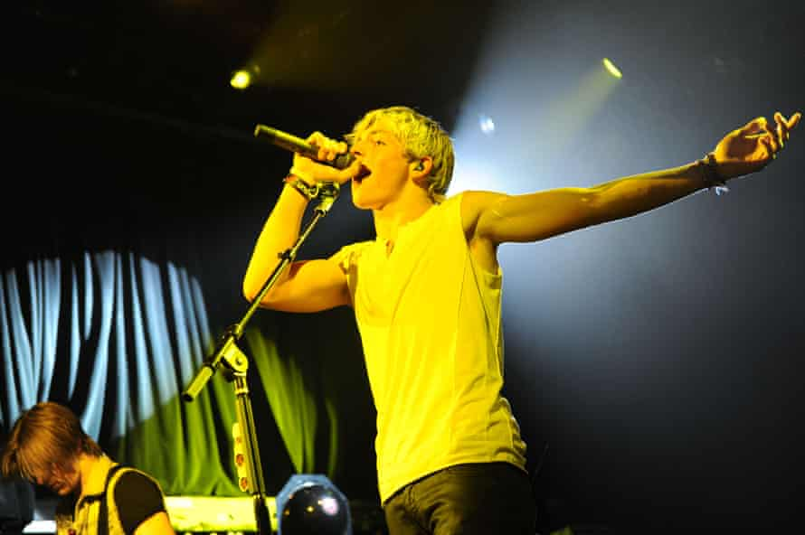 Ross Lynch on stage with R5 in New York in 2013