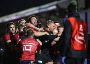 Munster's Jean Kleyn in the middle of a scuffle between the two teams.
