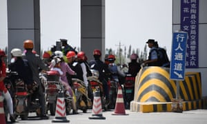 police checkpoint on a road near a facility believed to be a re-education camp where mostly Muslim ethnic minorities are detained, north of Akto in China's western Xinjiang region