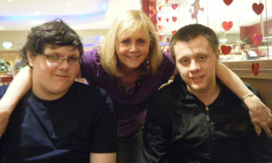 Linda Tuppen, who has died after developing suspected coronavirus, with her sons James, left, and Rob